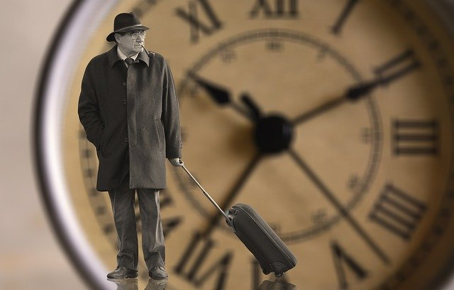 紳士と時計盤